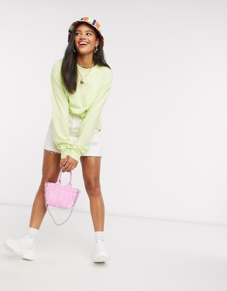 ASOS DESIGN oversized long sleeve t-shirt with cuff detail in washed lime