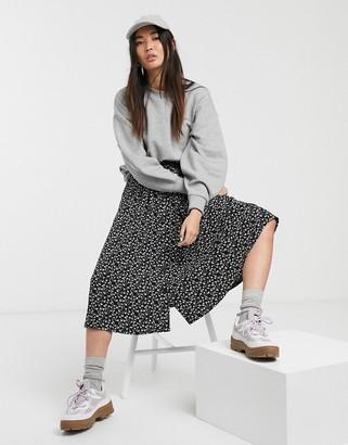 Monki Sigrid button through floral midi skirt in black