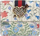 Gucci GucciTotem New Flora print leather clutch