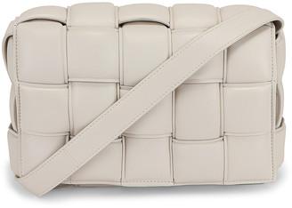 Bottega Veneta Padded Cassette Crossbody Bag in Chalk & Gold | FWRD