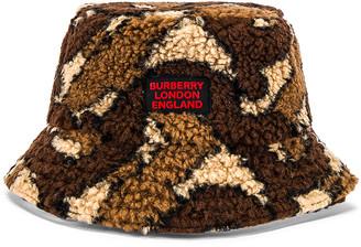 Burberry Fleece Bucket Hat in Bridle Brown IP Pattern | FWRD