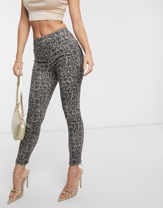 Spanx Slim Built In contoured Power Waistband jegging in snake print