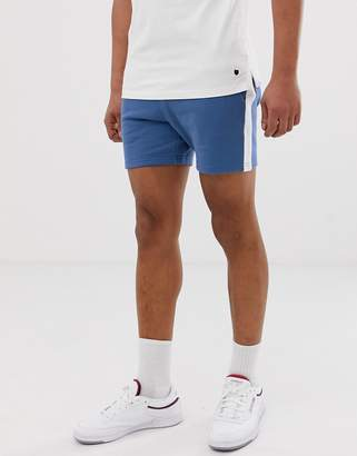 Asos Design DESIGN jersey skinny shorts in shorter length with side stripe in blue