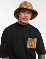 Asos Design DESIGN two-piece wide brim bucket hat in brown and orange print
