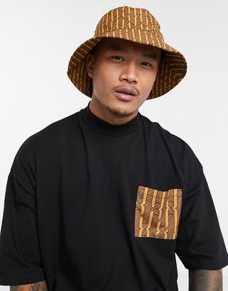 Asos DESIGN two-piece wide brim bucket hat in brown and orange print