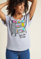 L-1220 Your book-loving buddies are sure to get a real kick out of you rockin' this grey T-shirt! An adorable offering from Out of Print, this relaxed-fit tee boldly broadcasts your idea of a good time with its colorful graphic of library picks headed back to th