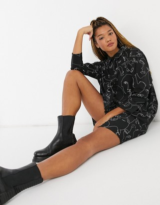 Monki Moa recycled polyester faceprint mini shirt dress in black