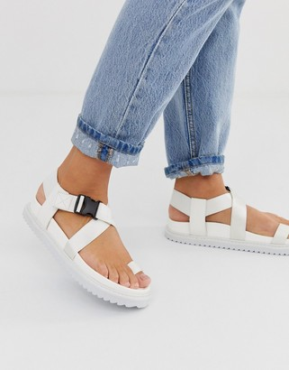 ASOS DESIGN Freestyle toe loop sporty sandals in white