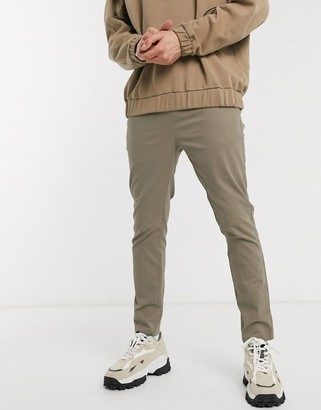 Asos DESIGN skinny chinos with elastic waist in light khaki