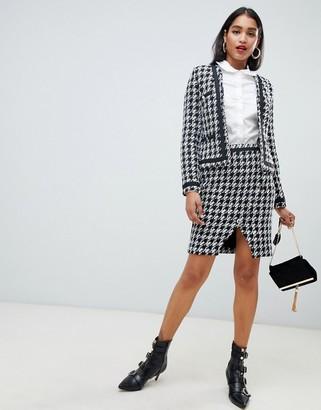 Morgan houndstooth asymmetric button front skirt in mono