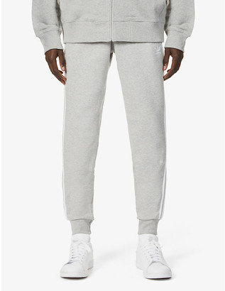adidas Three-stripe cotton-jersey tapered jogging bottoms