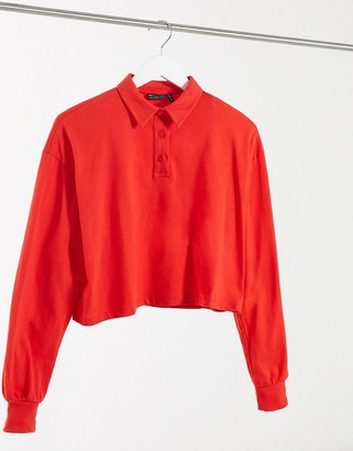 ASOS DESIGN boxy crop polo with long sleeves in red