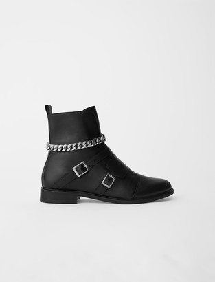 Maje Flat ankle boots with straps and chain