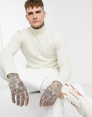 ASOS DESIGN muscle fit jersey waffle roll neck in beige