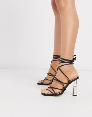Truffle Collection tie leg heeled sandals with clear heel in black