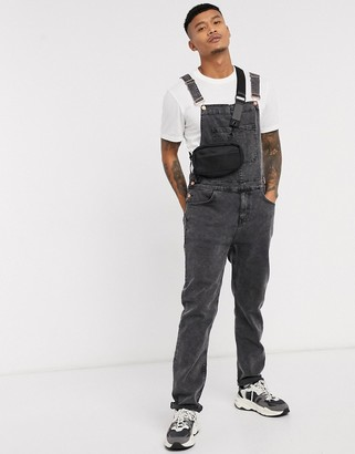 ASOS DESIGN denim dungarees in black acid wash