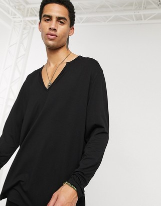 ASOS DESIGN longline relaxed long sleeve jersey t-shirt in black