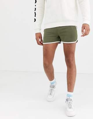 Asos Design DESIGN jersey runner shorts in khaki-Green