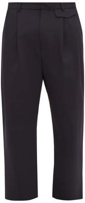 Wyatt Deveaux Pleated Cropped Satin Back Crepe Trousers - Mens - Navy