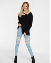 Express asymmetrical cut-out waffle tunic sweater