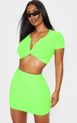 PrettyLittleThing Neon Green Slinky Twist Front Short Sleeve Crop Top