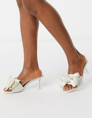 ASOS DESIGN Honesty bow mules with flared heel in ivory