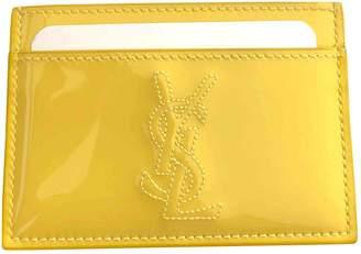 Saint Laurent Belle de Jour Yellow Patent leather Purses, wallets & cases