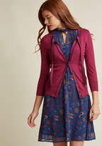 Mcs1133 Well aren't you an all-out retro darling in this purple cardigan from our ModCloth namesake label! Between its navy blue piping, lovely tied neckline atop a flirty keyhole, and cropped sleeves, this super-soft sweater will have everybody echoing our preci