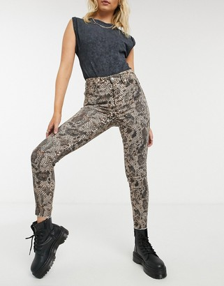 Free People high-rise animal-print jeans in multi