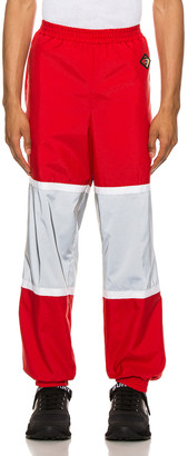 Burberry Trackpants in Bright Red | FWRD