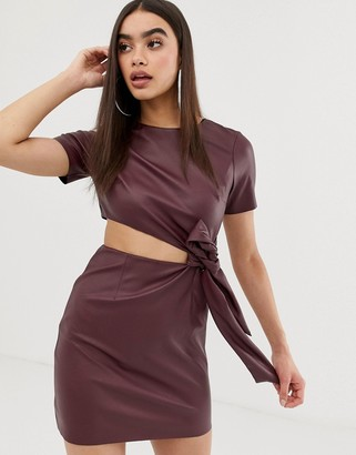 Asos DESIGN faux leather mini dress with cut out side