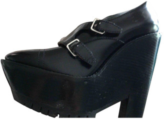Burberry Black Leather Mules & Clogs
