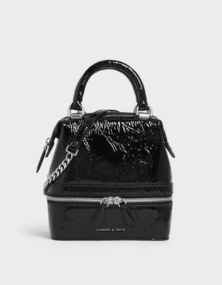 Charles & Keith Wrinkled Patent Two-Way Zip Boxy Bag