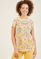 MCT1294A Vintage-inspired and versatile, this sheer blouse from our ModCloth namesake label is a true wardrobe win! The Peter Pan collar, smocked yoke, and subtle bust ruffle of this pastel floral top await a whole slew of occasions and you're just the stylista to