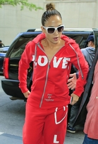 jennifer lopez  Who made  Jennifer Lopezs red sweatshirt, red sweatpants, white tote handbag, and tan boots?