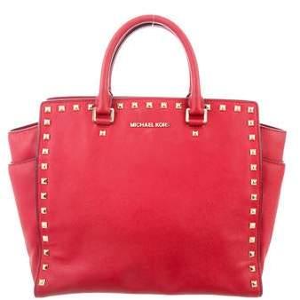 ef9f108cfd09 Michael Kors Studded Handbag - ShopStyle