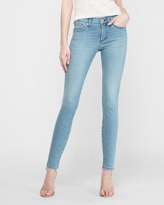 Express Mid Rise Light Wash Skinny Jeans