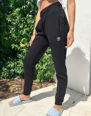 adidas Essentials cuffed joggers in black