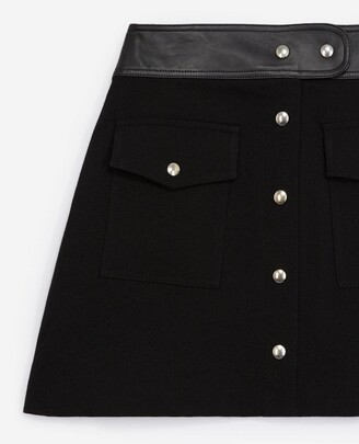 The Kooples Short black skirt in wool with leather belt