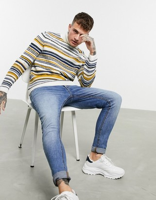 Asos DESIGN knitted textured roll neck jumper in multi colour stripes