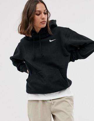 Nike mini swoosh oversized hoodie with pocket in black