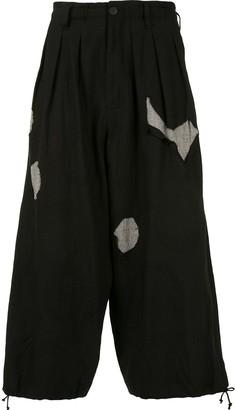 Yohji Yamamoto Ripped-Effect Cropped Trousers