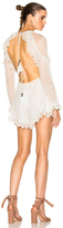 Zimmermann Divinity Scallop Ruffle Playsuit in White.