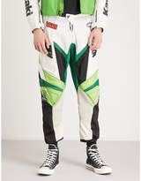 NOT APPLICABLE Kawasaki panelled logo-print woven tapered trousers