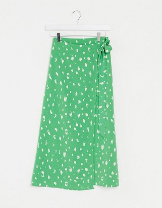 Monki Fran wrap polka dot midi skirt in green
