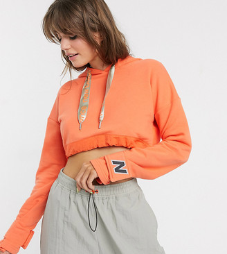 New Balance Utility Pack cropped hoodie in orange exclusive at ASOS
