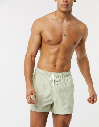 ASOS DESIGN swim shorts in beige with pintuck front in short length