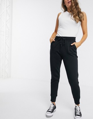 Converse high waisted slim fit black joggers
