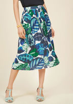 MCB1269 Accessorizing this pleated skirt with an optimistic attitude is one sure way to achieve your aspirations! A high-waisted A-line from our ModCloth namesake label, this ivory chiffon bottom boasts blue-and-green tropical leaves and a guided, glamorous vibe.