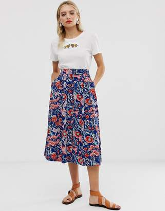Monki floral print buttoned midi skirt in blue